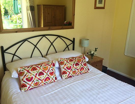 double bedroom with garden patio